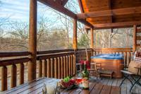 Hot tub and eating area outside on deck