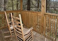 Relax in the rockers on the deck on this one bedroom cabin near Gatlinburg, TN