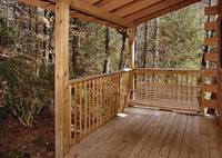 Swing and enjoy nature at this cabin near Gatlinburg and pigeon forge tn
