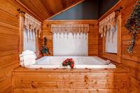 Soak in large jacuzzi tub in this honeymoon cabin