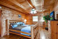 Bedroom with TV in Country Hideaway - 2 bedroom Pigeon Forge cabin