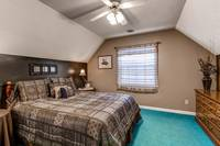 Queen bedroom of this 2 bedroom affordable chalet