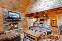 Stone gas fireplace, flat screen TV, and a comfy seating area