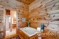 Jacuzzi tub located in the upstairs master bedroom with King bed