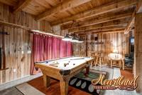 Pool table with adjoining sitting area with fireplace