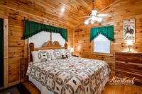 King size bed in this affordable cabin near Gatlinburg