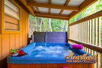 Bubbling hot tub to relax at this 2 bedroom chalet near Pigeon Forge - Affordable!
