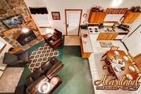 View of the living room and kitchen of this 2 bedroom Pigeon Forge chalet rental Deer Wood