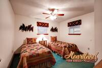 Bedroom with 2 twin beds in this Pigeon Forge chalet