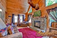 Living room with fireplace and flat screen TV in this Pigeon Forge Tennessee cabin