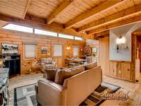 Relax near the fire place in this one bedroom pet friendly cabin