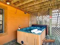 Bubbling hot tub to relax in on the deck