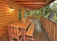 Wooden porch swing and table - 4 bedroom cabin in Gatlinburg