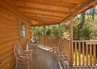 Porch with wooden chairs - 4 bedroom cabin in Gatlinburg