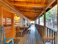 Wooden furniture and porch swing of Bear Hug - 4 bedroom in Gatlinburg cabin rental