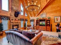 Living room with fireplace and TV of Bear Hug - 4 bedroom in Gatlinburg cabin rental - Sleeps 8
