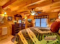 Bedroom with flat screen TV of Bear Hug - 4 bedroom in Gatlinburg cabin rental