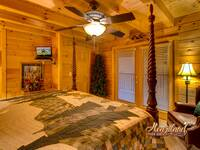 Bedroom of Bear Hug with flat screen TV - 4 bedroom in Gatlinburg cabin rental