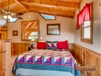 King sized bed in this Pigeon Forge cabin rental