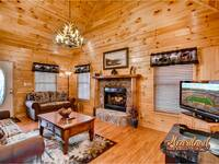 Living room with fireplace and flat screen TV - Two Bedroom Cabin Rental