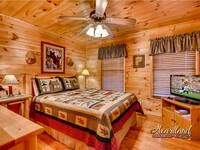 Master bedroom on the main level of this 2 bedroom cabin in Wears Valley near Townsend