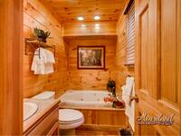 Bathroom with jacuzzi tub to relax on your vacation in the Smoky Mountains