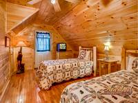 Twin beds in the upstairs bedroom with a full bathroom