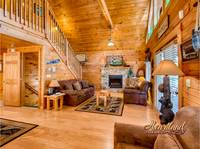 Living Room has a Queen Sleeper Sofa, Cable TV, WIFI, and Fireplace in this 5 bedroom cabin in Pigeon Forge