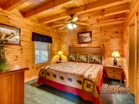 King sized bed and ceiling fan