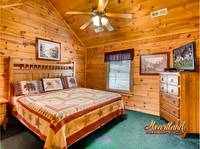 King size bed with ceiling fan and flat screen TV