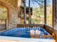Hot tub outdoors on the lower level of this cabin near Dollywood
