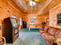 Game Room is located with a Jukebox, Video Games, Pool Table, Cable TV and a Queen sleeper sofa