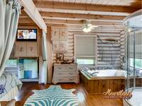 Jacuzzi tub in the bedroom of this cabin near Pigeon Forge