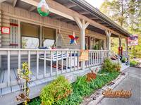 Front porch of LJ's Cozy Getaway - 1 bedroom cabin in Pigeon Forge, TN