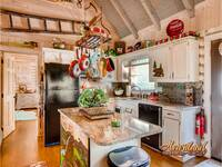 Full kitchen with granite countertops and Keurig Coffee Marker