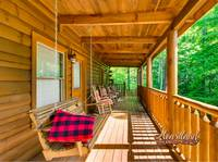 4 wooden rocking chairs and porch swing