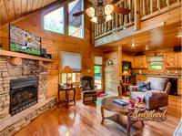 Gatlinburg cabin rental living room with flat screen TV and stacked stone gas fireplace