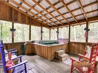 Hot tub on the deck with rocking chairs