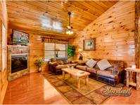 Living area of cabin with fireplace, flat screen TV and WiFi