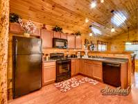 Full kitchen to cook while on vacation stay is this 3 bedroom cabin