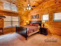 Master bedroom pigeon forge cabin rental with King bed