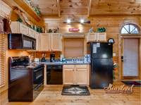 Full kitchen in this affordable 1 bedroom cabin near Pigeon Forge