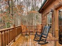 Wooden rocking chairs on the back deck with hot tub - perfect for your morning cup of coffee