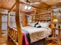 King bed in this one bedroom cabin near Gatlinburg and Pigeon Forge