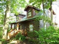 Stargazer is a 3 bedroom cabin between Pigeon Forge and Gatlinburg located in a wooded setting with mountain views