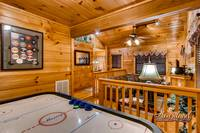 one bedroom cabin with air hockey game Cuddlers Paradise
