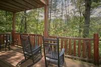 Porch area with wooden rocking chairs
