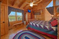 Queen size bed with TV in the 2nd bedroom of this Pigeon Forge chalet