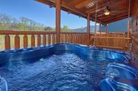 Relax in the outdoor hot tub at this 2 bedroom chalet in the Smokies