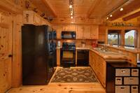 Fully equipped kitchen in this 2 bedroom cabin near Pigeon Forge and Wears Valley